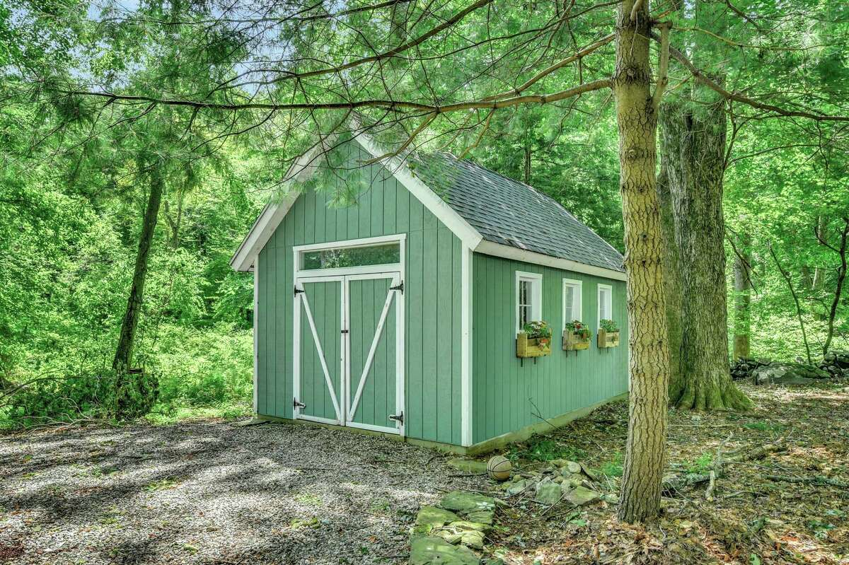 The property has a large storage shed that could serve as a garden or potting shed.