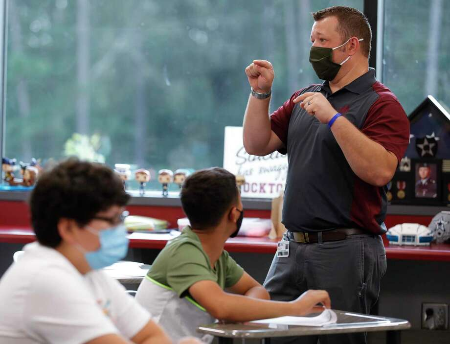 Seventh grade history teacher Robert Simard instructs students at the start of class at Stockton Junior High School on the first day of in-person school for Conroe ISD Sept. 8. in Conroe. With updated guidelines from the Texas Education Agency, school districts will be able to remove students who are struggling with virtual learning from the online platform. Conroe ISD plans to consider this option but would not implement it until the next semester at the earliest. Photo: Jason Fochtman, Houston Chronicle / Staff Photographer / 2020 © Houston Chronicle