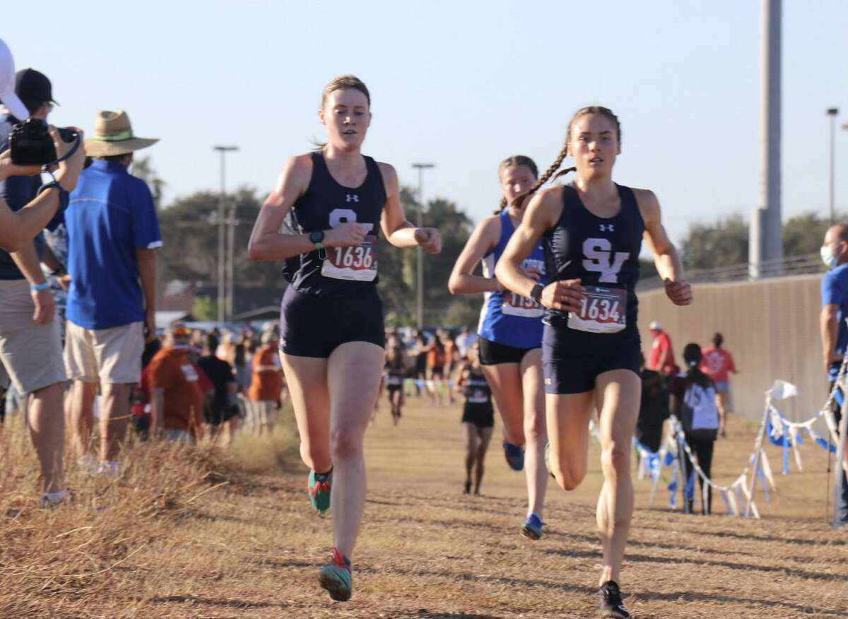 Smithson Valley's Sara Scott, left, and Amalie Mills set the pace at the Region IV-6A cross country race on Tuesday and they finished first and third.