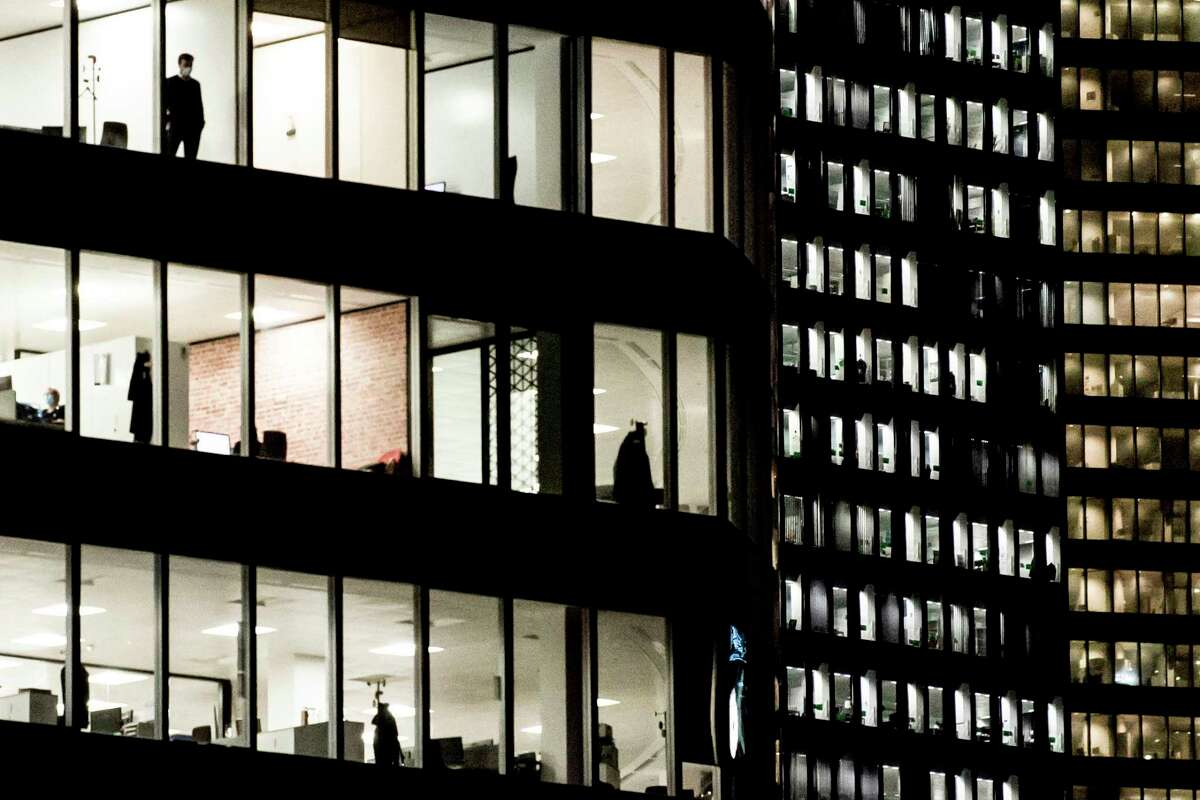 People working in the offices in the business district of la Defense near Paris, on the fourth day of a lockdown aimed at containing the spread of the novel coronavirus (Covid-19), on November 2, 2020.