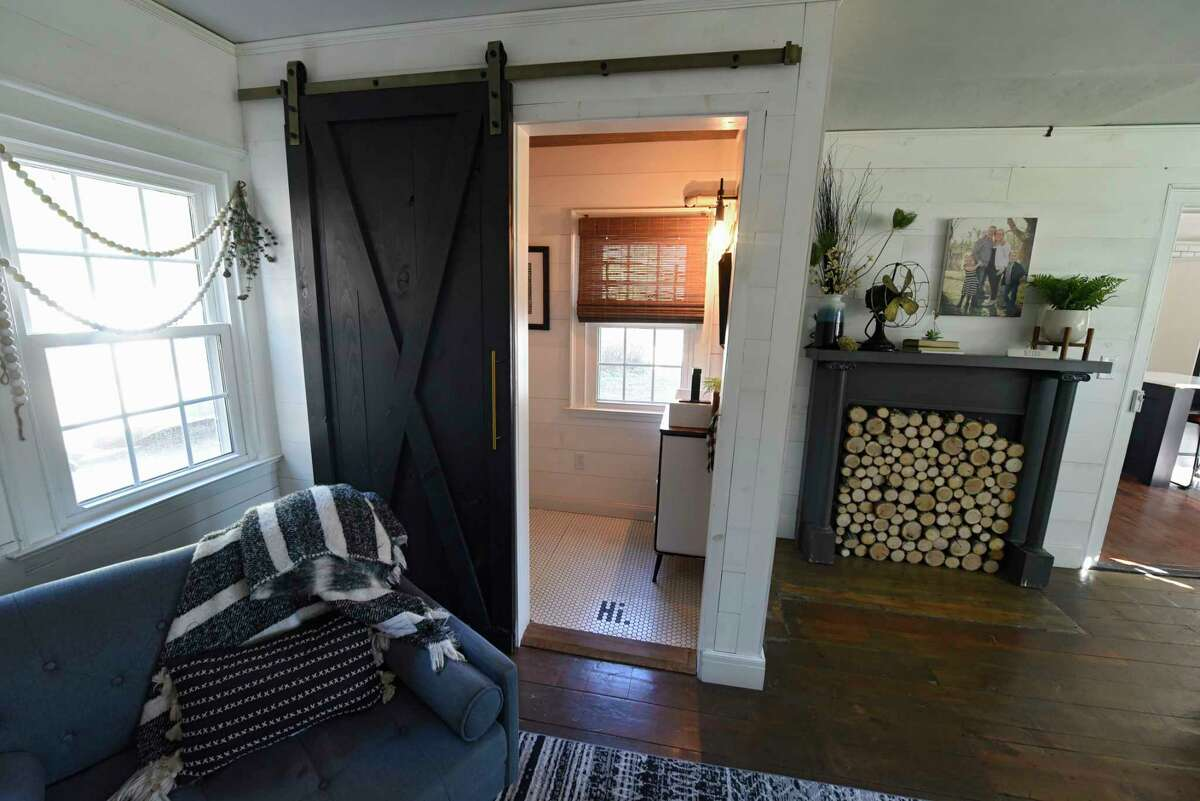 Barn door on renovated downstairs bathroom in Sarah and John Trop's historic home on Wednesday, Nov. 4, 2020 in Wynantskill, N.Y. Sarah and John Trop bought the home with a goal of restoring it. (Lori Van Buren/Times Union)