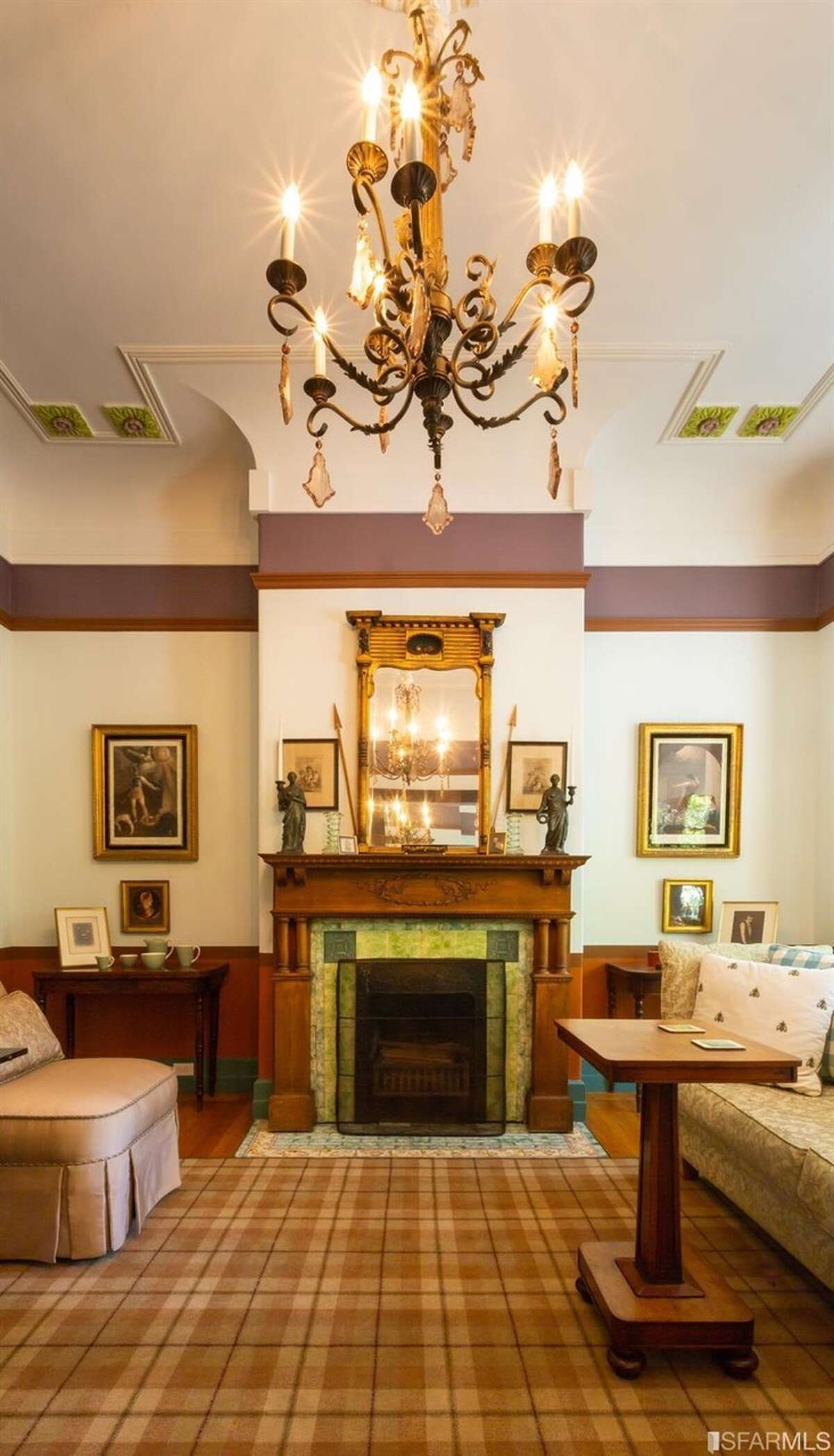 More original features can be found in the front room of the double parlor, including the ceiling details and fireplace. The current owners