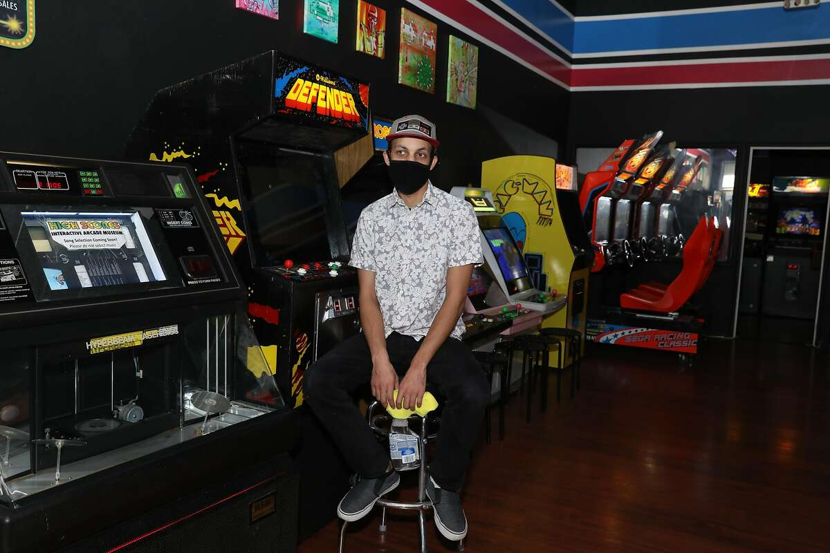 Jonathan Williams manages High Scores Arcade in Alameda. Open or not, he has to maintain the machines.