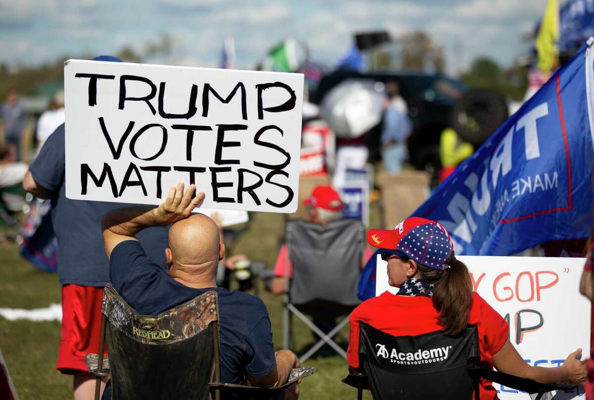 Hundreds gathered for a Defend Our President rally held at the Montgomery County Fairgrounds in Conroe, Saturday, Nov. 7, 2020.
