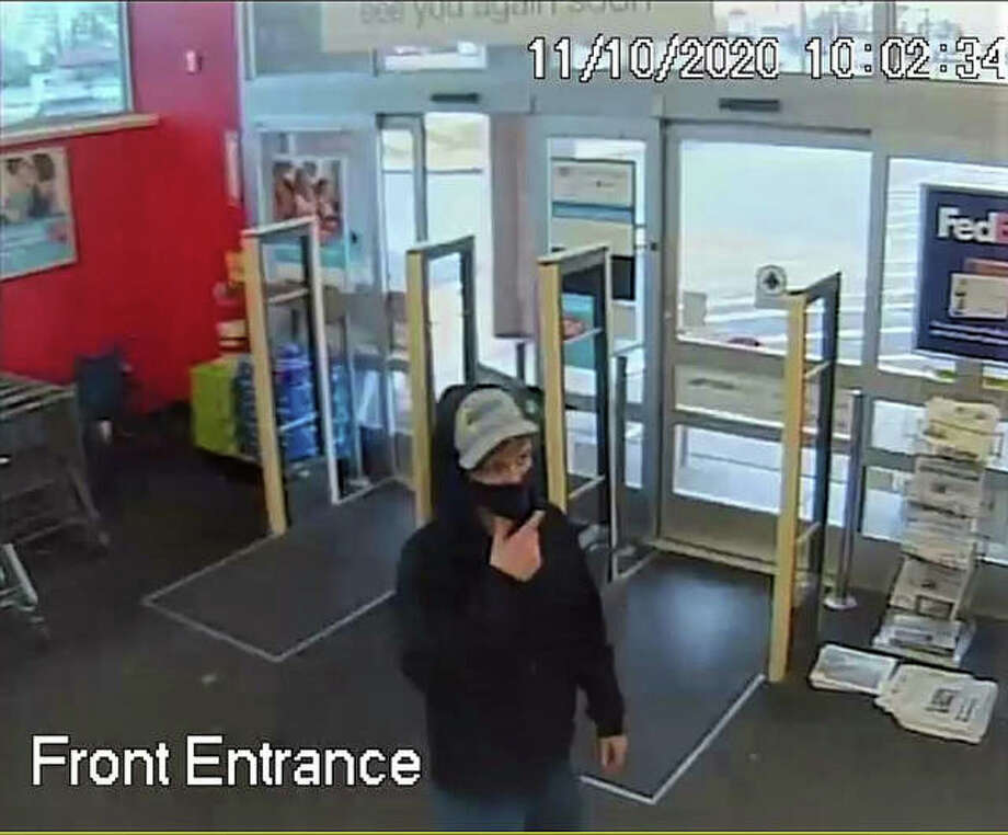 Walgreens surveillance camera image of robbery suspect, taken Tuesday.