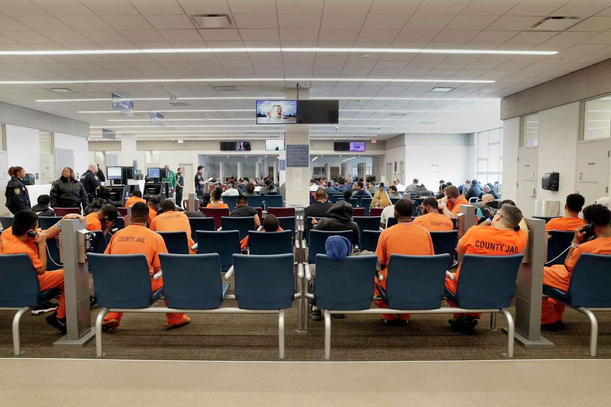 Detainees and inmates wait in the waiting room for various court and other processing events in the waiting room of the Harris County Joint Processing Center Thursday, March 5, 2020 in Houston.