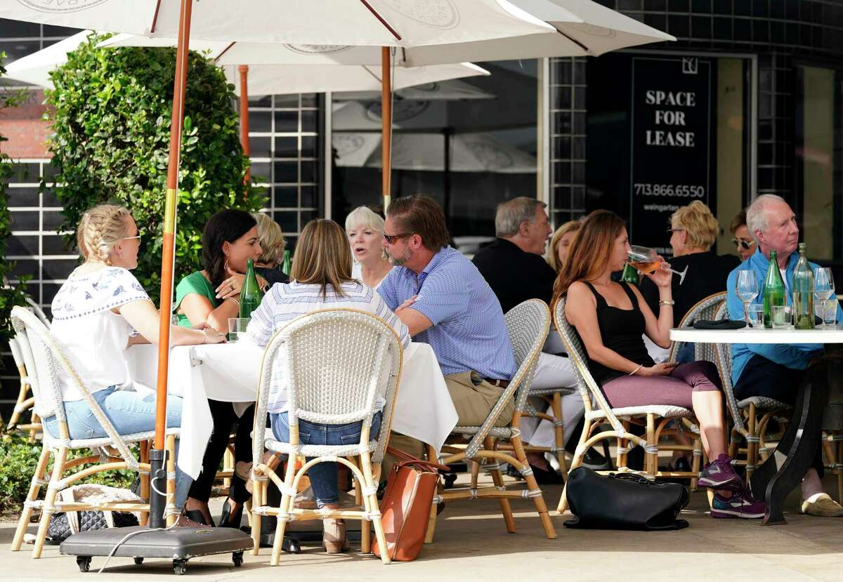People dine outside in the River Oaks shopping area amid the COVID-19 pandemic Tuesday. Texas has reached more than 1 million cases of COVID-19, making it the first state in the country to pass this milestone.