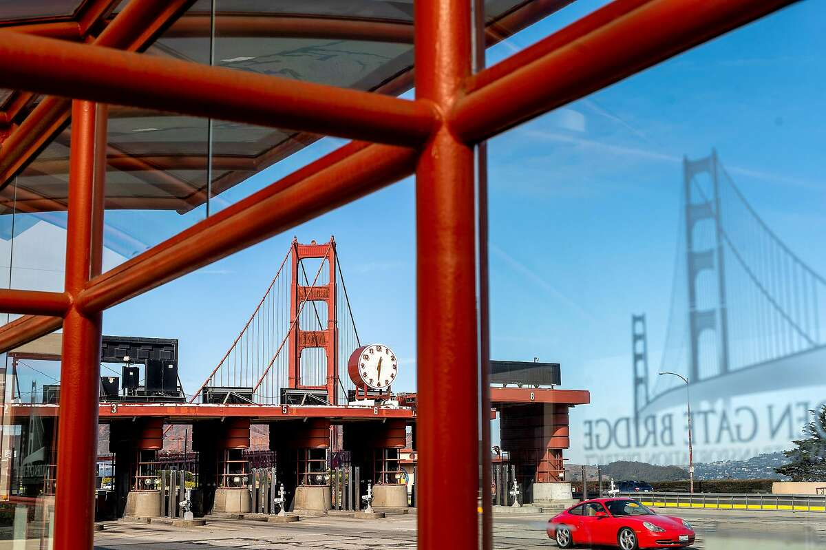 A car passes the Golden Gate Bridge toll plaza on Tuesday, Nov. 10, 2020, in San Francisco.