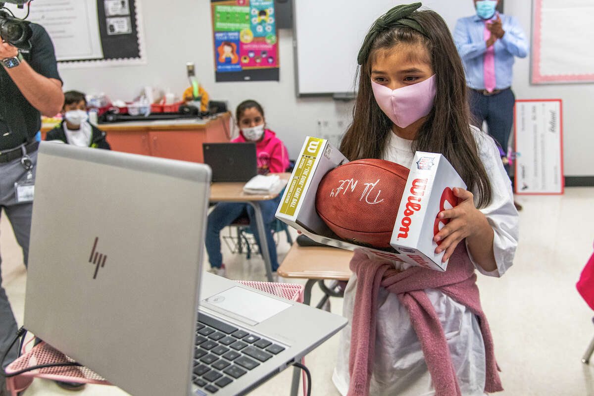 Houston ISD's Clemente Martinez Elementary School's third-grade student of the month shows off her Deshaun Watson autographed football after he surprised the class on Tuesday, Nov. 10, 2020.