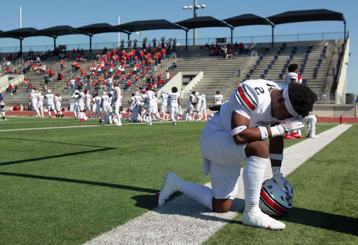 Atascocita defensive back Caleb Burton (2) prays before a District 21-6A high school football game at Turner Stadium, Saturday, Oct. 31, 2020, in Humble.