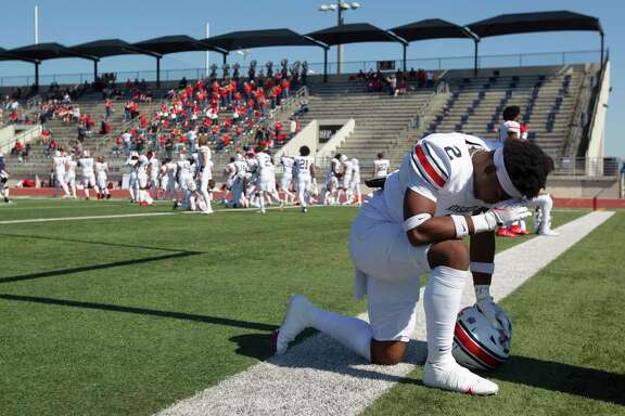 Atascocita defensive back Caleb Burton (2) prays before a District 21-6A high school football game at Turner Stadium, Saturday, Oct. 31, 2020, in Humble.