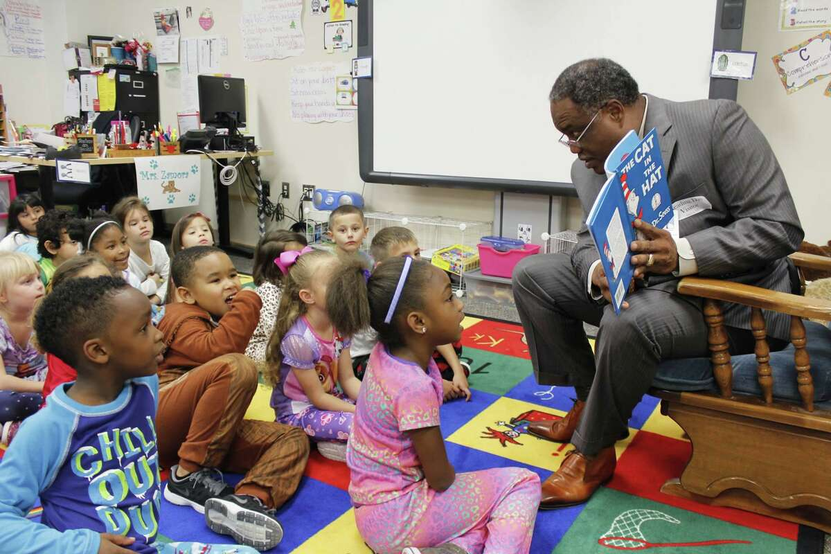 Lamar Consolidated ISD Superintendent of Schools Thomas Randle reads to students. The longtime administrator admits to liking to still spend time in the classroom.