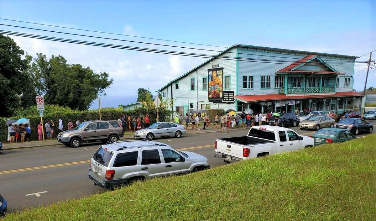 People line up in Hawi for the weekly food distribution from Kohala Cares.