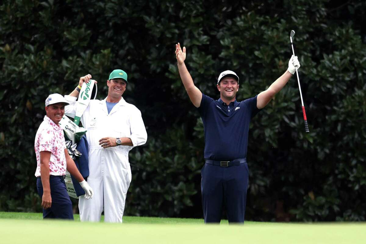 *** BESTPIX *** AUGUSTA, GEORGIA - NOVEMBER 10: Jon Rahm of Spain celebrates with Rickie Fowler of the United States after skipping in for a hole in one on the 16th during a practice round prior to the Masters at Augusta National Golf Club on November 10, 2020 in Augusta, Georgia.