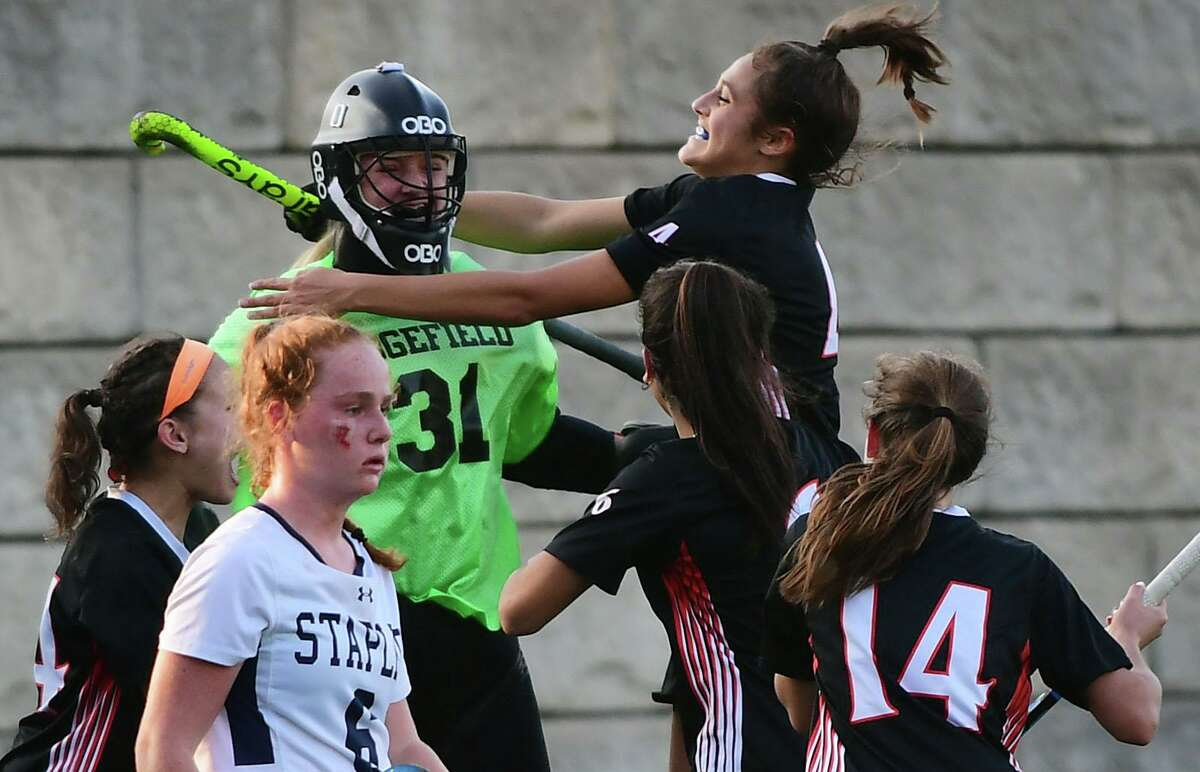 Ridgefield goalie Ella Williams celebrates with Aerin Krys after beating Staples in their FCIAC Central championship game Tuesday in Westport.