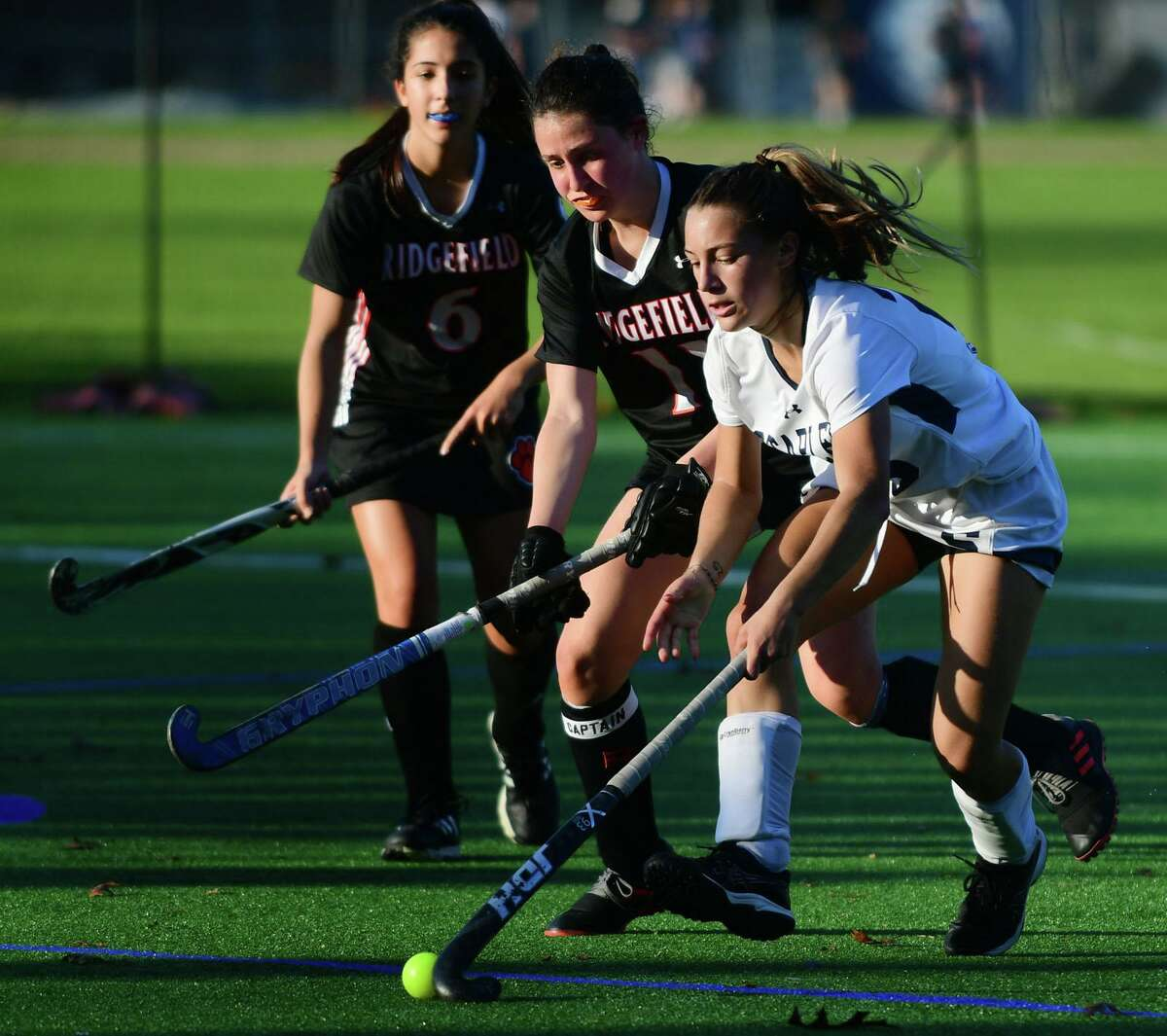 Ridgefield's Olivia DeStefano (11) and Staples' Jessica Leon (20) battle for the ball in their FCIAC Central championship game Tuesday.