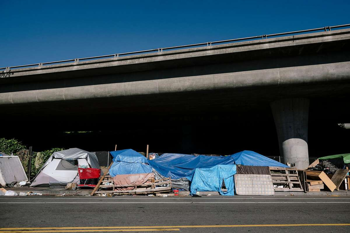 Tents of a homeless encampment line Martin Luther King Jr. Way in Oakland on May 28.