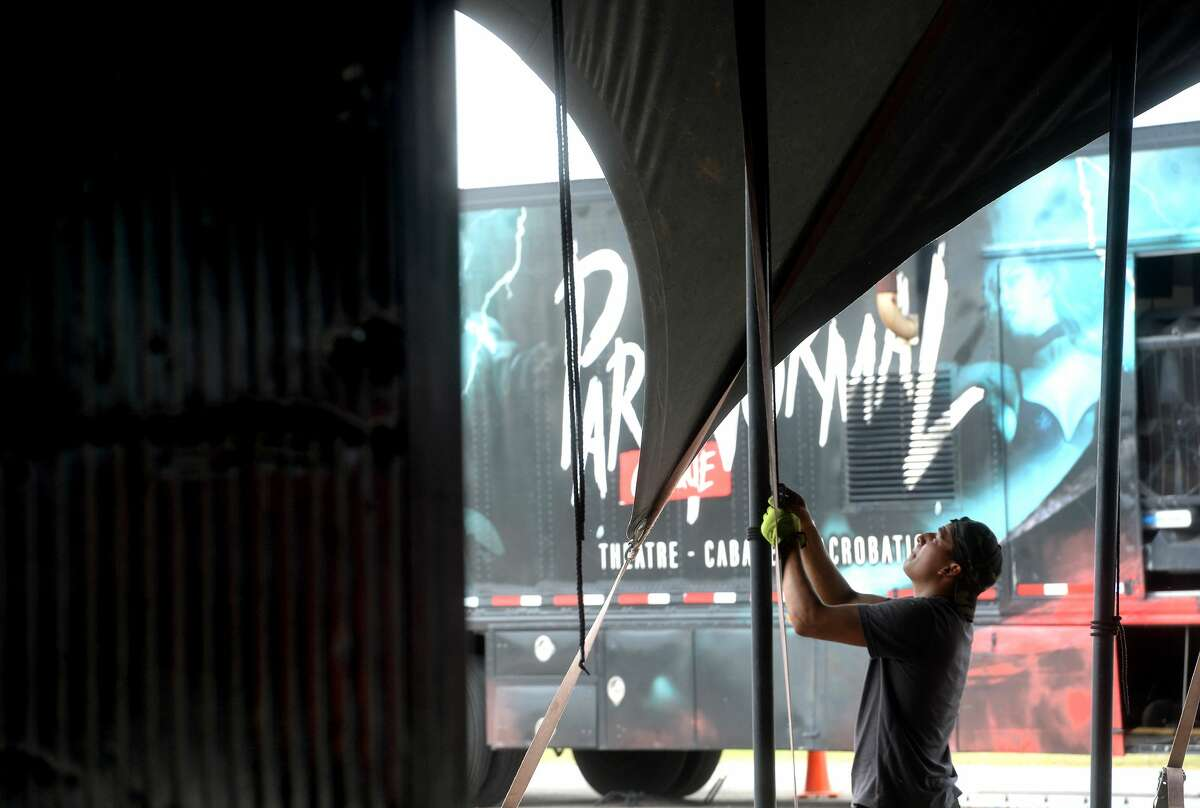 Crew members with Cirque Italia's Paranormal Cirque set up the big top venues Tuesday in preparation for Thursday's opening show at Ford Park. The adult-oriented circus will host shows through the weekend, and again next week Wednesday through Sunday. Children 13 - 17 will be admitted with adult accompaniment. Photo taken Tuesday, November 10, 2020 Kim Brent/The Enterprise
