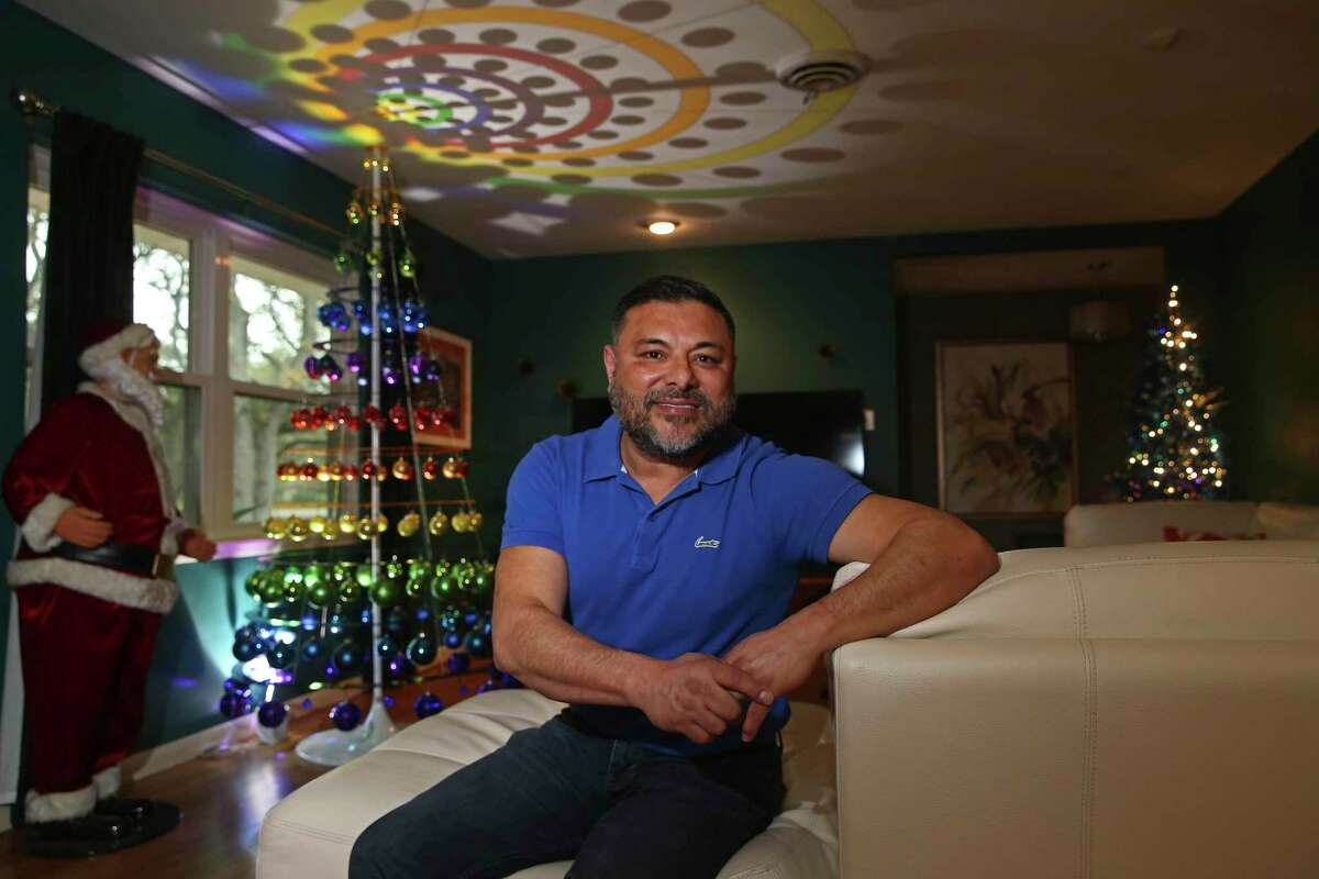 Jon Jimenez set up several Christmas trees and ornaments that were gifts from dear friends throughout his Castle Hills home even earlier than usual. He used the time to reflect on his friends through their connection with the ornaments as he placed them on the tree.
