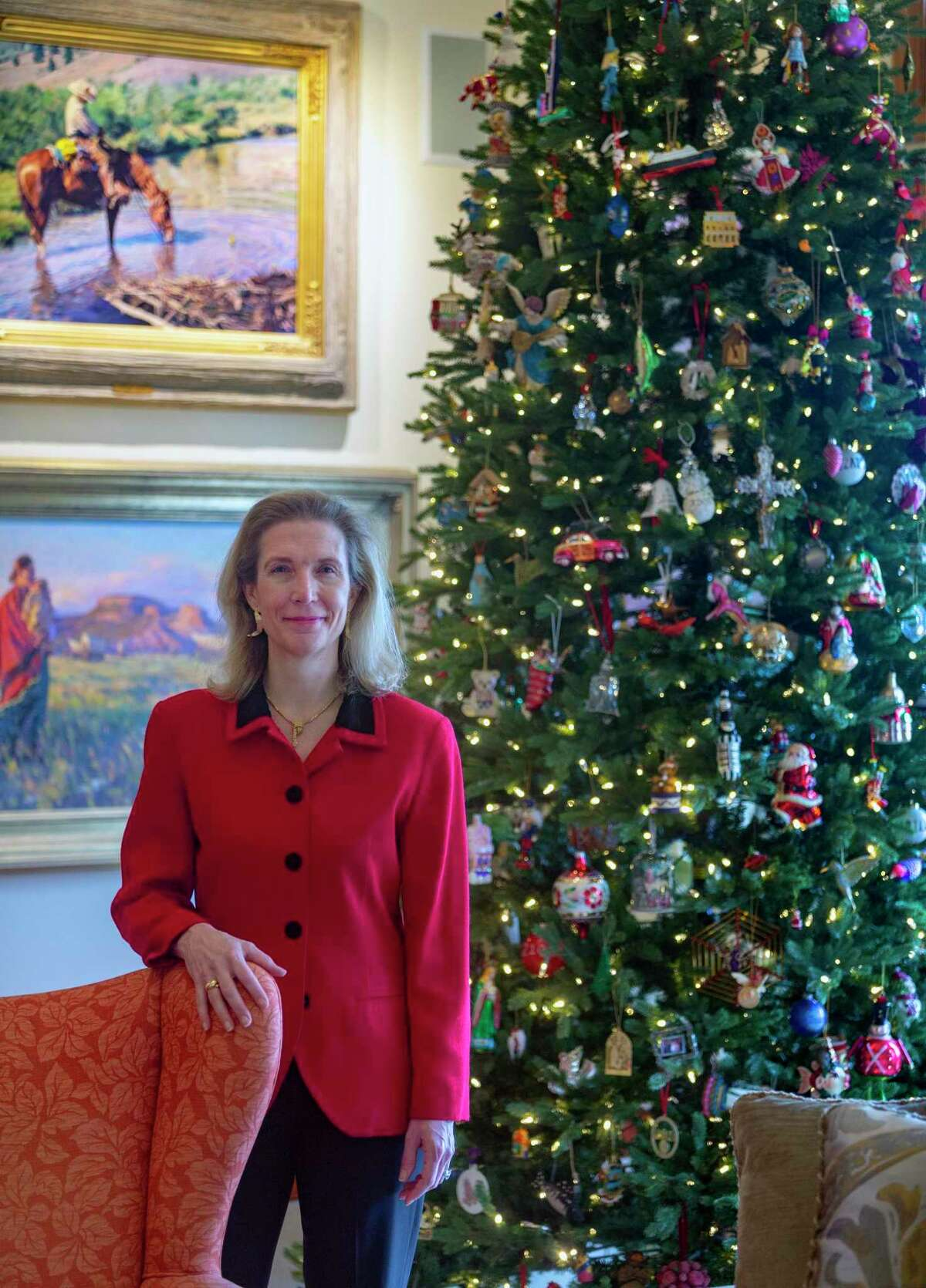 Abigail Kampmann in front of her Christmas tree. She decorated her home for Christmas early this year and inspired her friends to do the same.