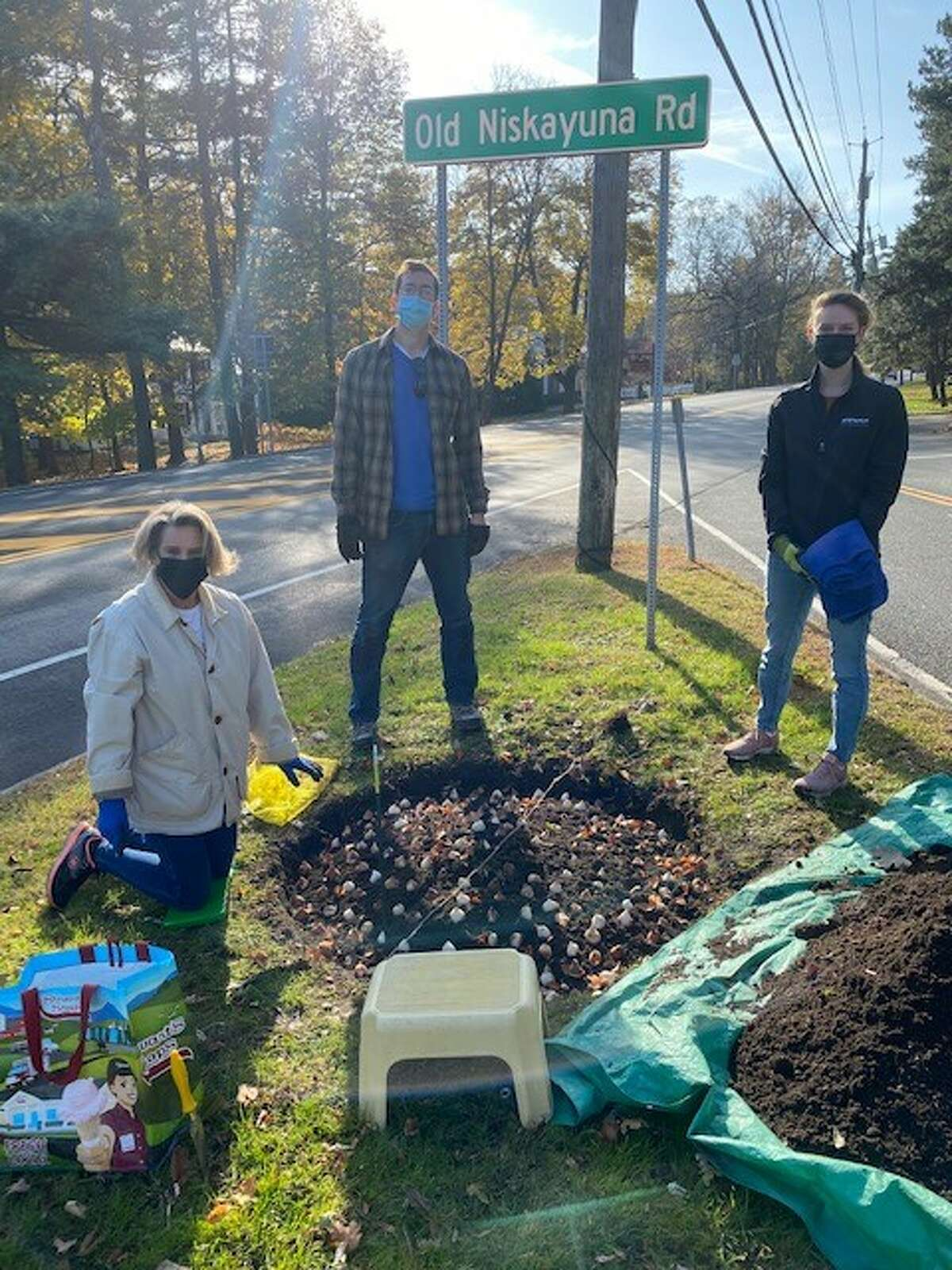 Volunteers from the Greater Loudonville Association plant bulbs to beautify the Loudonville Triangle off of Rte 9.