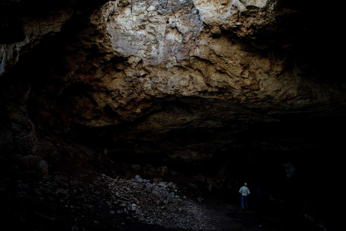 Bill Cofer walks inside the Frio Bat Cave on the Annandale Ranch in Sabinal, Texas, Feb. 14, 2020. The Edwards Aquifer Protection Program has spent more than $260 million in sales tax funds since 2000 to acquire about 160,000 acres of sensitive land over the aquifer. Sitting above the aquifer, the Annandale Ranch has been in Cofer's family for 130 years and in 2007, the San Antonio Water System bought a 7,553-acre conservation easement on the ranch- one of the last easements purchased by SAWS before the EAPP took over.