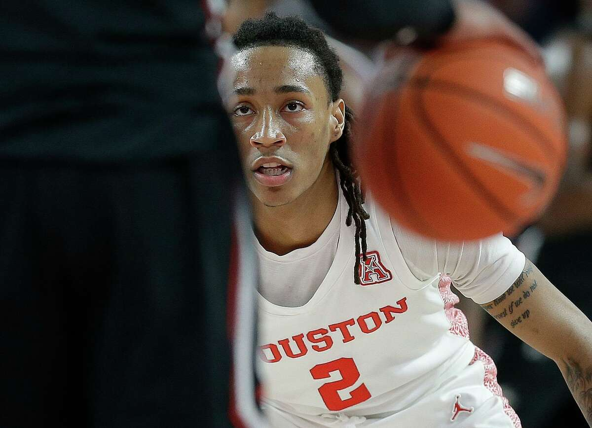 Houston coach Kelvin Sampson got a good look at Caleb Mills last year in a preseason scrimmage but the Cougars won't have those this season because of COVID-19 protocols.