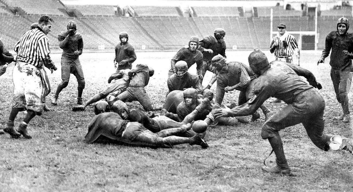 Dec. 2, 1950: Athletes from Polytechnic High School and Mission High fight for a ball after a blocked punt in a muddy title game at Kezar Stadium.