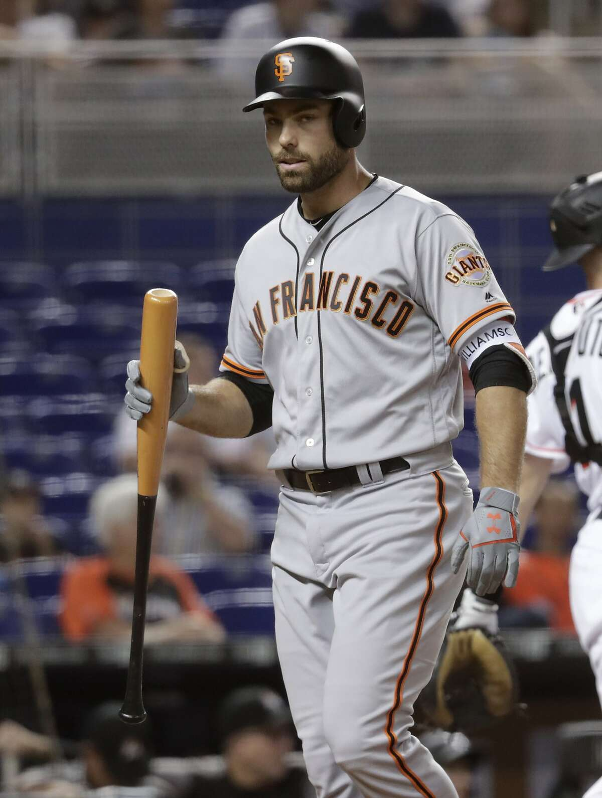 Then-Giants outfielder Mac Williamson strikes out in Miami in June 2018; a few weeks earlier he was hurt at AT&T Park.