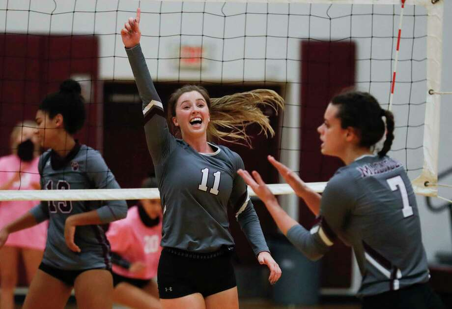 Magnolia setter Faith Lynch (11) reacts after a point by outside hitter Marissa Moffatt (7) during the first set of a District 19-5A high school volleyball match at Magnolia High School, Tuesday, Nov. 10, 2020, in Magnolia. Photo: Jason Fochtman, Houston Chronicle / Staff Photographer / 2020 © Houston Chronicle