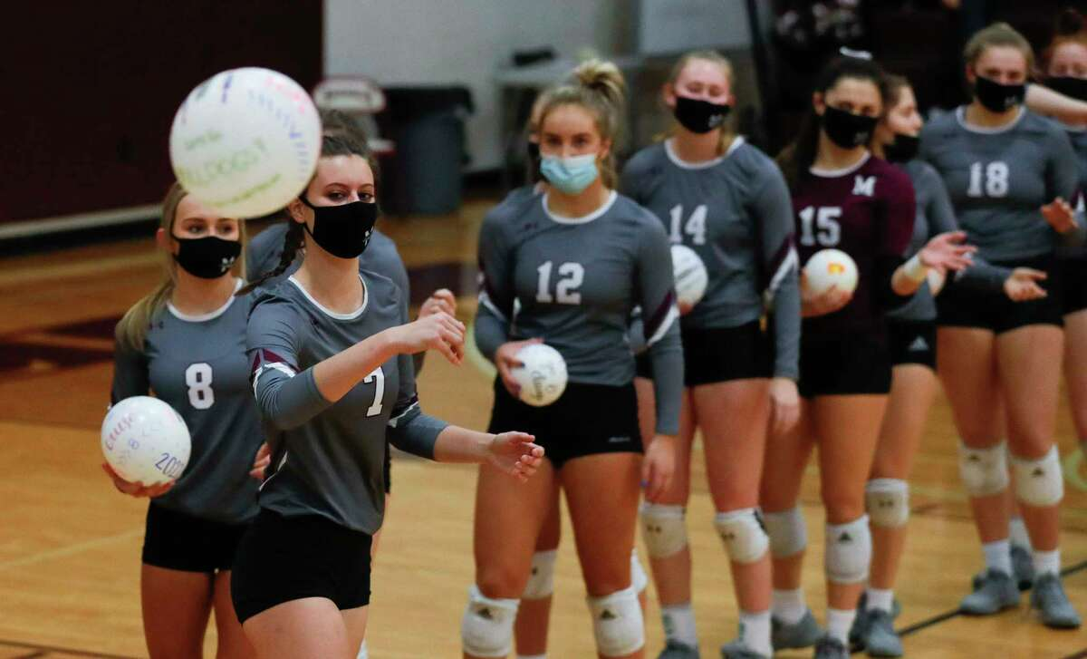 Magnolia opposite side hitter Marissa Moffatt (7) tosses a balloon into the stands during the first set of a District 19-5A high school volleyball match at Magnolia High School, Tuesday, Nov. 10, 2020, in Magnolia.