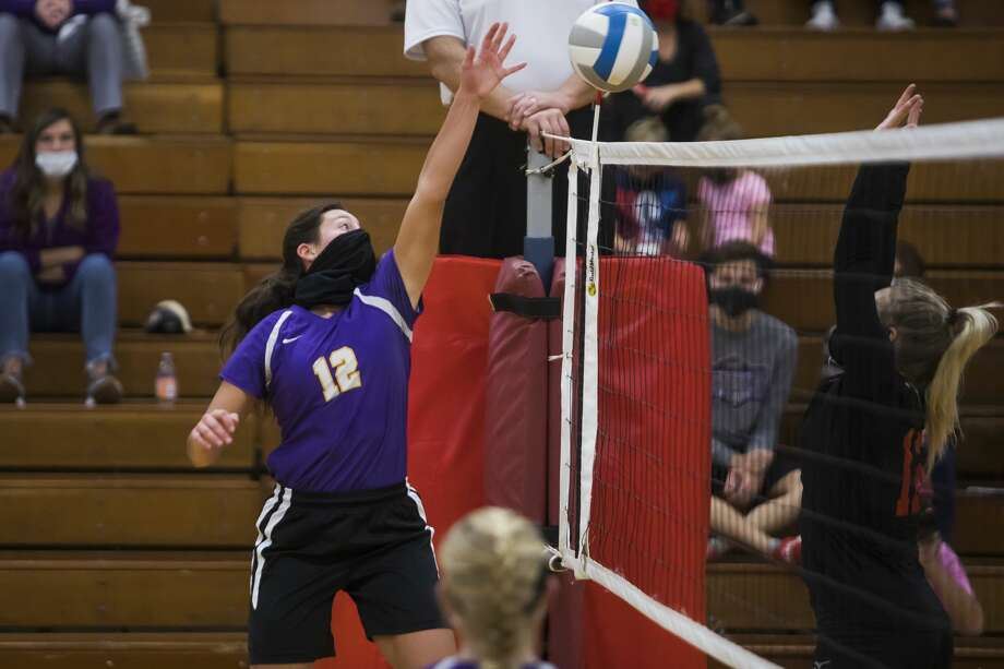 Calvary Baptist's Caroline Holdeman tips the ball during the Kings' regional semifinal loss to Dryden Tuesday, Nov. 10, 2020 at Mayville High School. (Katy Kildee/kkildee@mdn.net) Photo: (Katy Kildee/kkildee@mdn.net)