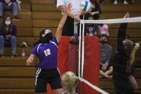 Calvary Baptist's Caroline Holdeman tips the ball during the Kings' regional semifinal loss to Dryden Tuesday, Nov. 10, 2020 at Mayville High School. (Katy Kildee/kkildee@mdn.net)