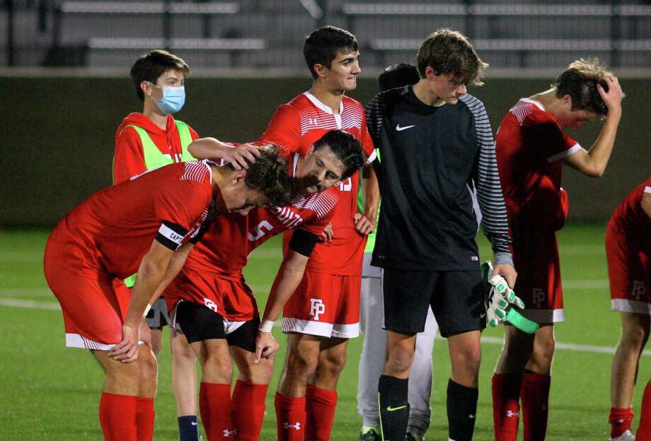 Fairfield Prep players react after their 1-0 loss to Fairfield Ludlowe in the FCIAC East boys soccer championship on Tuesday. Photo: Christian Abraham / Hearst Connecticut Media / Connecticut Post