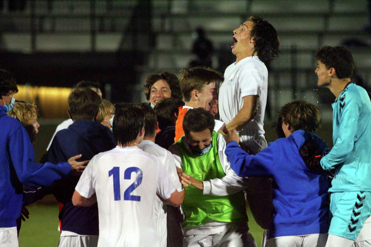 Fairfield Ludlowe players celebrate after defeating Fairfield Prep 1-0 in FCIAC East boys soccer championship action in Fairfield, Conn., on Tuesday Nov. 10, 2020.