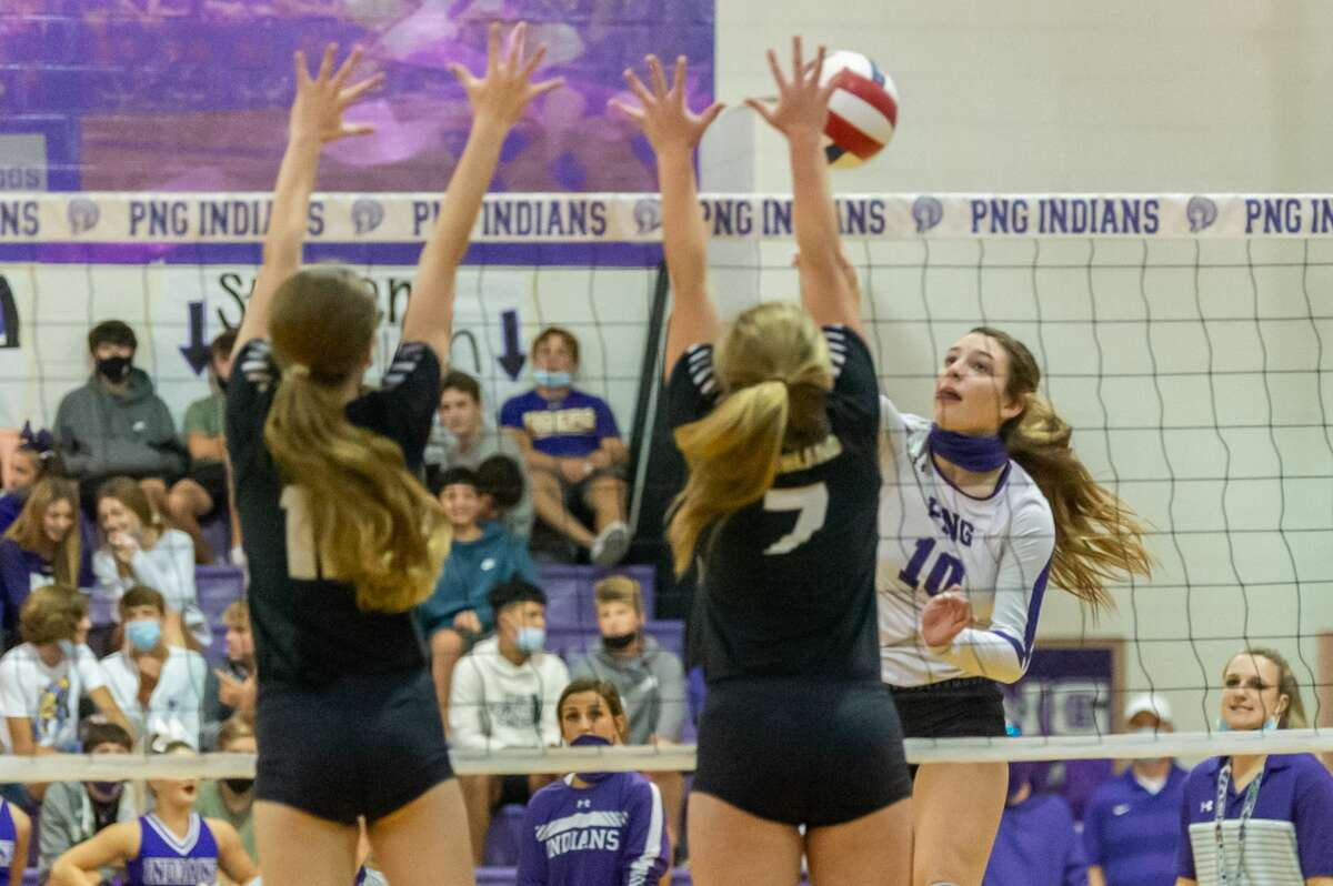 PN-G's Addison Bost (10) hits a shot over the net in the first set. Nederland and Port Neches-Groves volleyball squared off in a Mid-County Match-up on Tuesday night. Photo made on November 10, 2020. Fran Ruchalski/The Enterprise