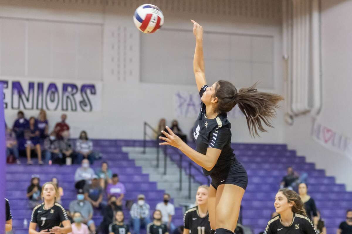 Lady Bulldog Katie Perez (9) goes up high for a shot in the second set. Nederland and Port Neches-Groves volleyball squared off in a Mid-County Match-up on Tuesday night. Photo made on November 10, 2020. Fran Ruchalski/The Enterprise