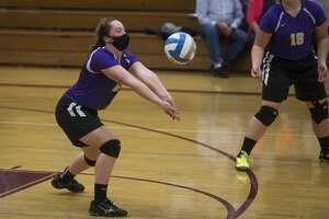 Calvary Baptist's Caitlyn Dickerson bumps the ball during the Kings' regional semifinal loss to Dryden Tuesday, Nov. 10, 2020 at Mayville High School. (Katy Kildee/kkildee@mdn.net)