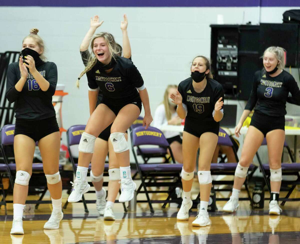 Montgomery volleyball players react after winning the second set of a District 20-5A volleyball match against Porter at Montgomery High School on Tuesday, Nov. 10, 2020.