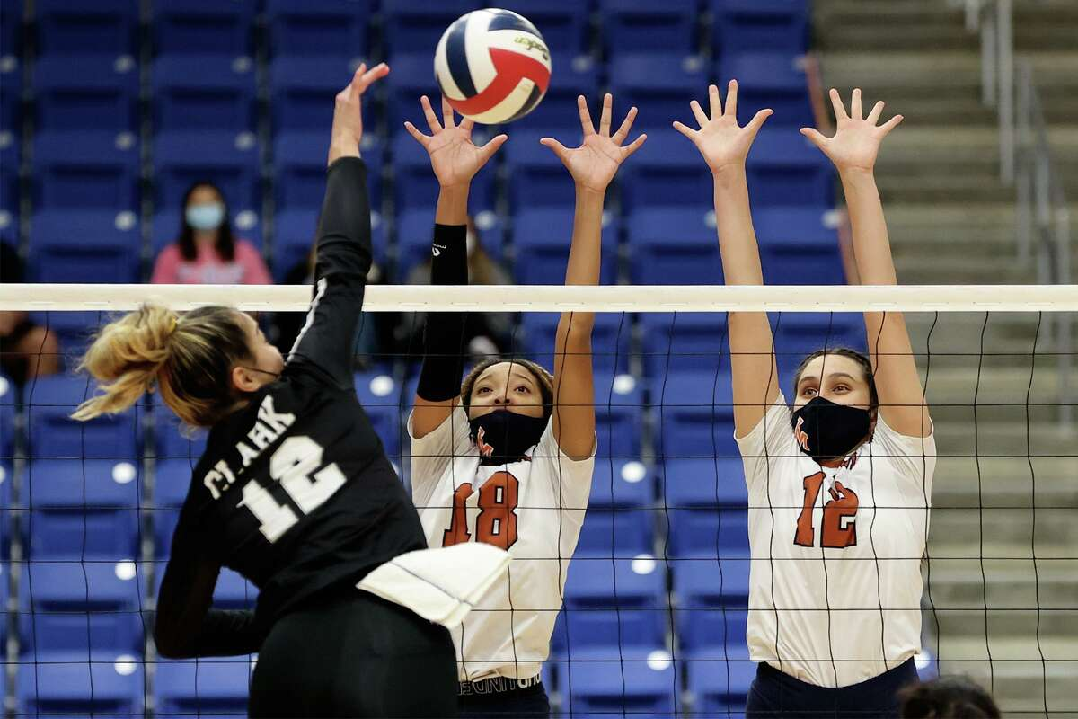 Madison's Madyleine Torres, right, and Dallasstar Johnson try to block a shot by Clark's Kyleigh Garrett during their District 28-6A volleyball match at Northside Gym on Tuesday, Nov. 10, 2020. Clark won the match in four sets: 25-23, 25-21, 20-25, 25-22.
