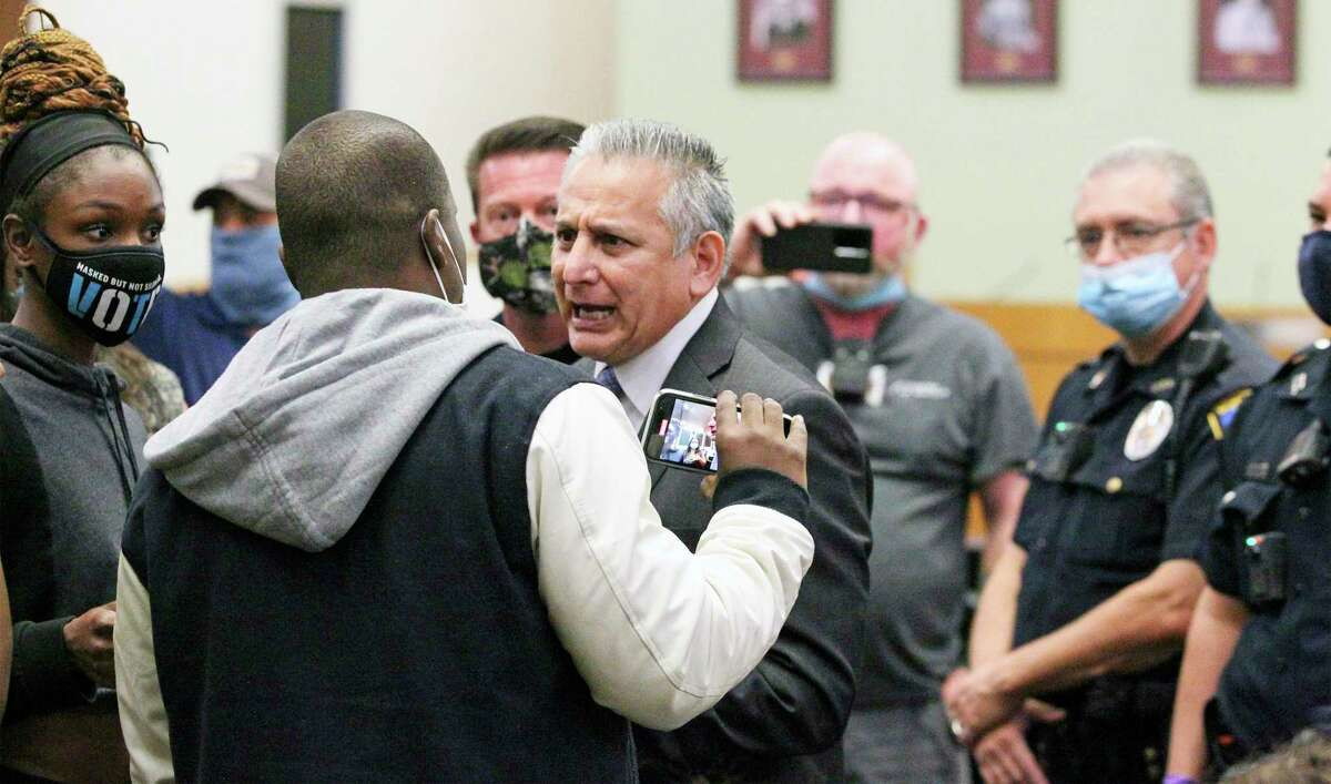 Mayor Ralph Gutierrez negotiates speaking tim with supporters of Zekee Rayford as they stage a protest during the Schertz city council meeting on Nov. 10, 2020.