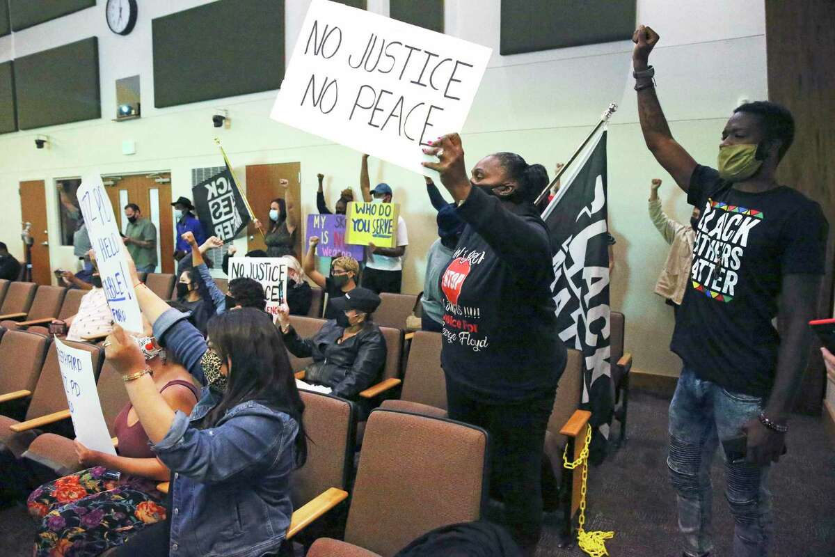 Supporters of Zekee Rayford stage a protest during the Schertz city council meeting on Nov. 10, 2020.