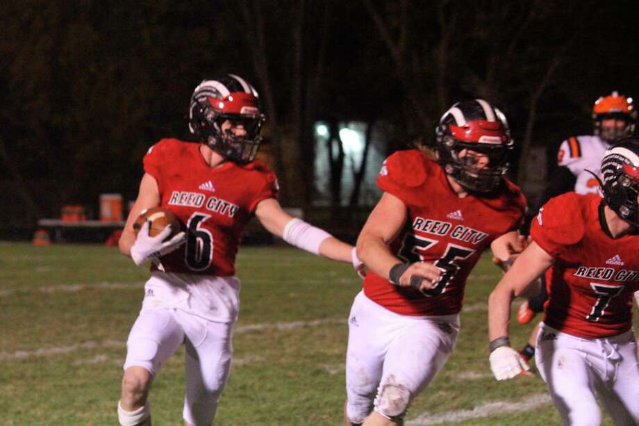 Reed City's Landon Tomaski (6) gets blocking support from teammate Teddy Cross in Friday's playoff game vs. Cheboygan on Oct. 30. (Herald Review photo/John Raffel)  Attachments area