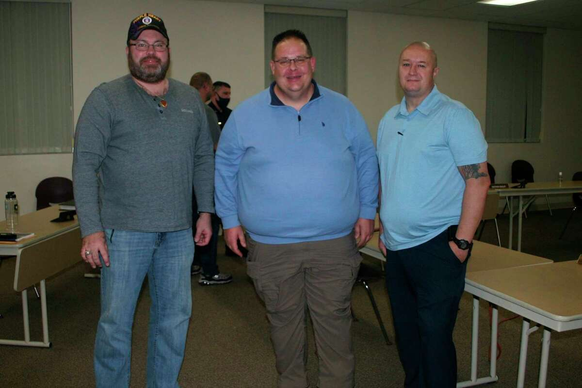 Newly elected Mayor Roger Meinert (center) welcomes newly elected council members Russ Nehmer (far left) and Brad Nixon (far right) at the council meeting Nov. 9. Nehmer and Nixon were sworn in as council members earlier in the day. (Herald Review photo/Cathie Crew)