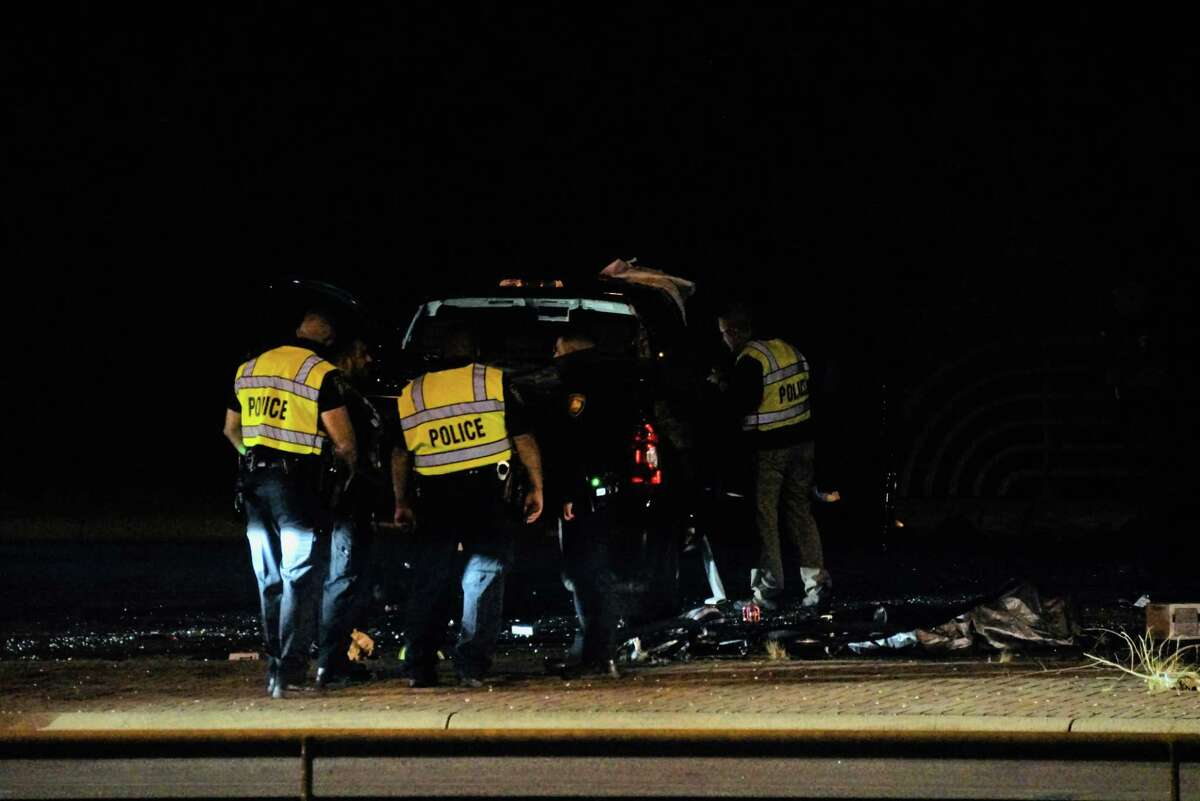 San Antonio police investigate a collision Tuesday night between an officer's SUV and a stolen pickup that occurred after a chase near West Military Drive and Old Pearsall Road.