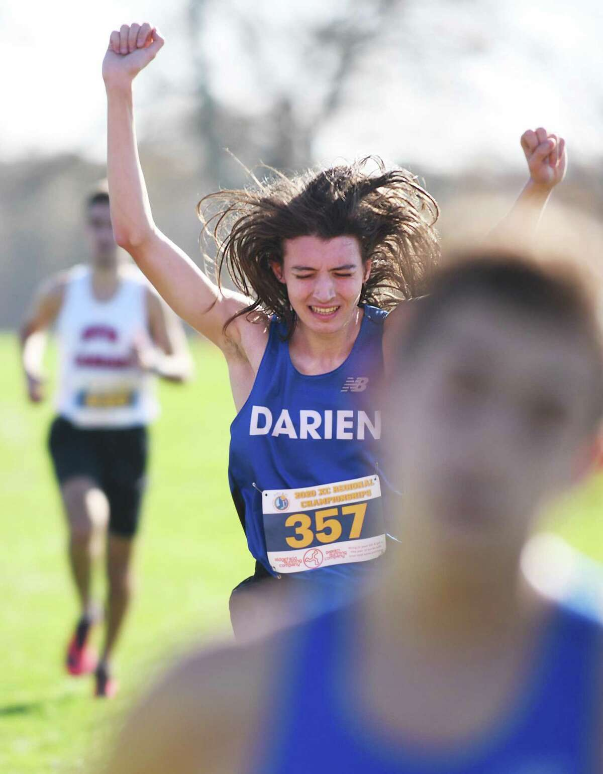 Darien's Evan O'Rourke crosses the finish line with a time of 17:08 to take fourth place in the West Region heat of the FCIAC boys cross country championship at Waveny Park in New Canaan on Nov. 4.