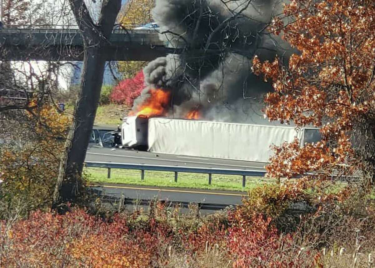 A tractor-trailer fire on I-91 in East Windsor, Conn., after a rollover crash on Tuesday, Nov. 10, 2020.