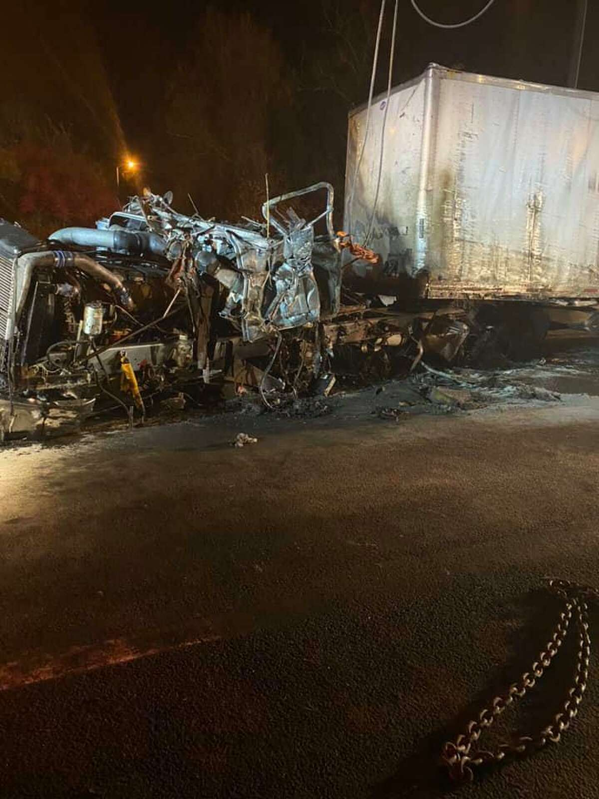 Crews on scene for a tractor-trailer rollover crash and fire on I-91 in East Windsor, Conn., on Tuesday, Nov. 10, 2020.