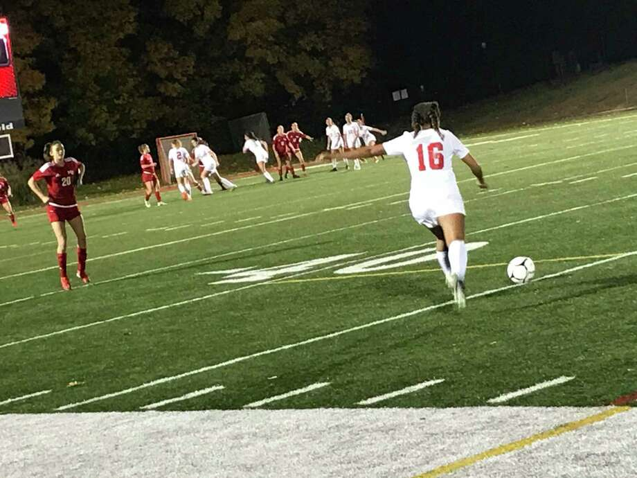 Greenwich's Skyler Scavo takes a free kick during the second half second half of a girls soccer game between New Canaan and Greenwich on Tuesday, November 11, 2020, in New Canaan.