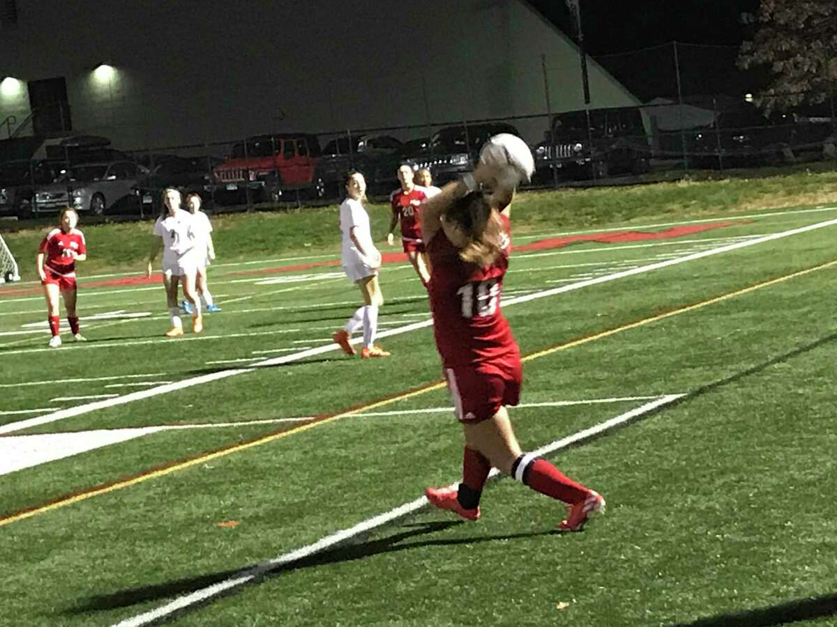 New Canaan's Katharine Byrne throws the ball in during the second half of a girls soccer game between New Canaan and Greenwich on Tuesday, November 11, 2020, in New Canaan.